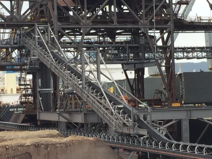 Wharf conveyor system loads coke